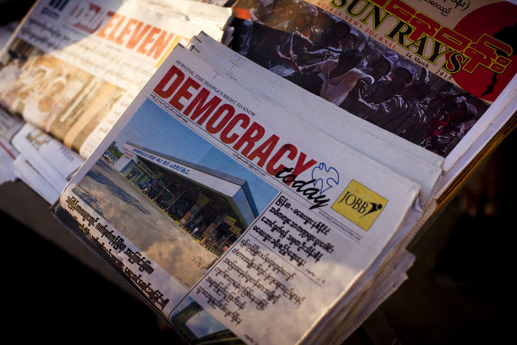 Close up of newspapers for sale in Yangon, Myanmar Day Democracy For Sale Front Page Myanmar News News Stand Newspaper Street