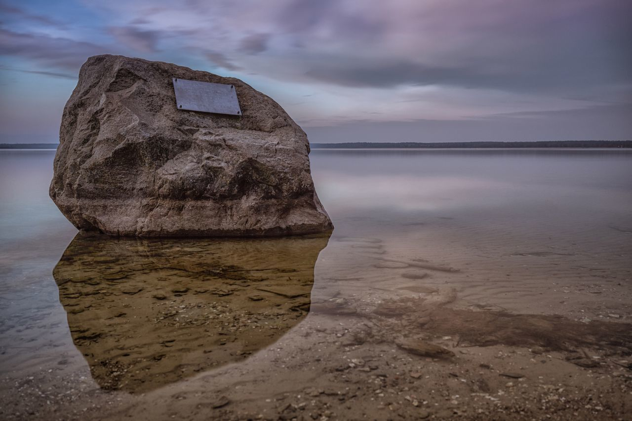 sea, beach, sky, water, nature, tranquility, sand, cloud - sky, tranquil scene, beauty in nature, rock - object, scenics, horizon over water, outdoors, no people, travel destinations, day, sunset