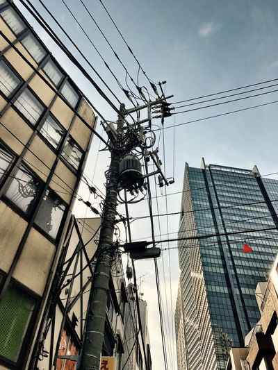 Architecture Building Exterior Built Structure Low Angle View Sky Power Line  Cable Electricity  Day City Connection Outdoors Electricity Pylon Power Supply No People Skyscraper Tokyo Japan Photography EyeEmJapan Low Angle View Clear Sky Streetphotography Shotoniphone7 IPhoneography Electric Wire