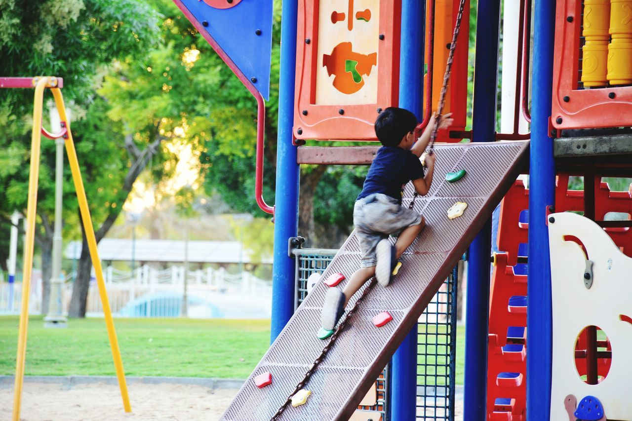 Child Multi Colored One Girl Only One Person Playground Childhood Outdoors People Playing Day Park Play Time Play Area Kids Kid Playing