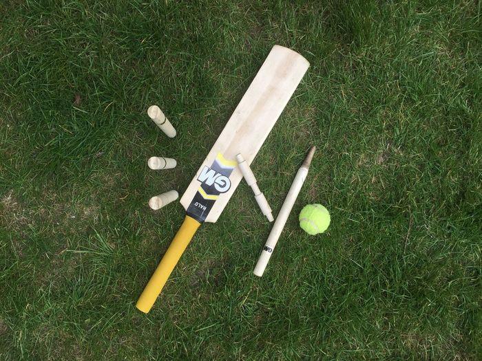 Children's cricket set on grass Grass No People Outdoors Cricket Bat High Angle View