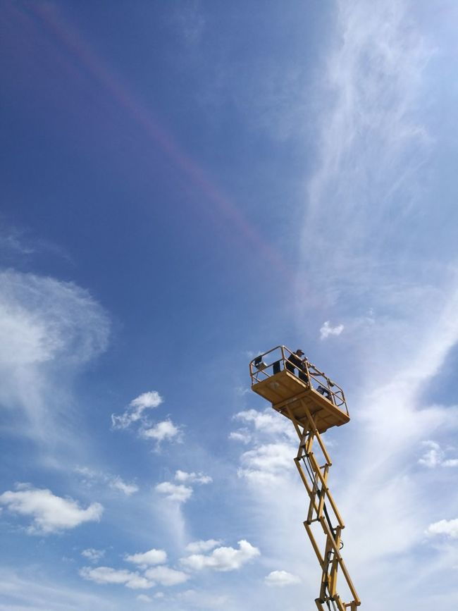 EyeEm Selects EyeEmNewHere Cloud - Sky Sky Low Angle View Day Outdoors No People Technology Industry Elevator Yellow Construction Work Height Angle View Point EyeEmBestPics Epsom Sunny Day Cloudy Blue Sky And Clouds Hard Hat