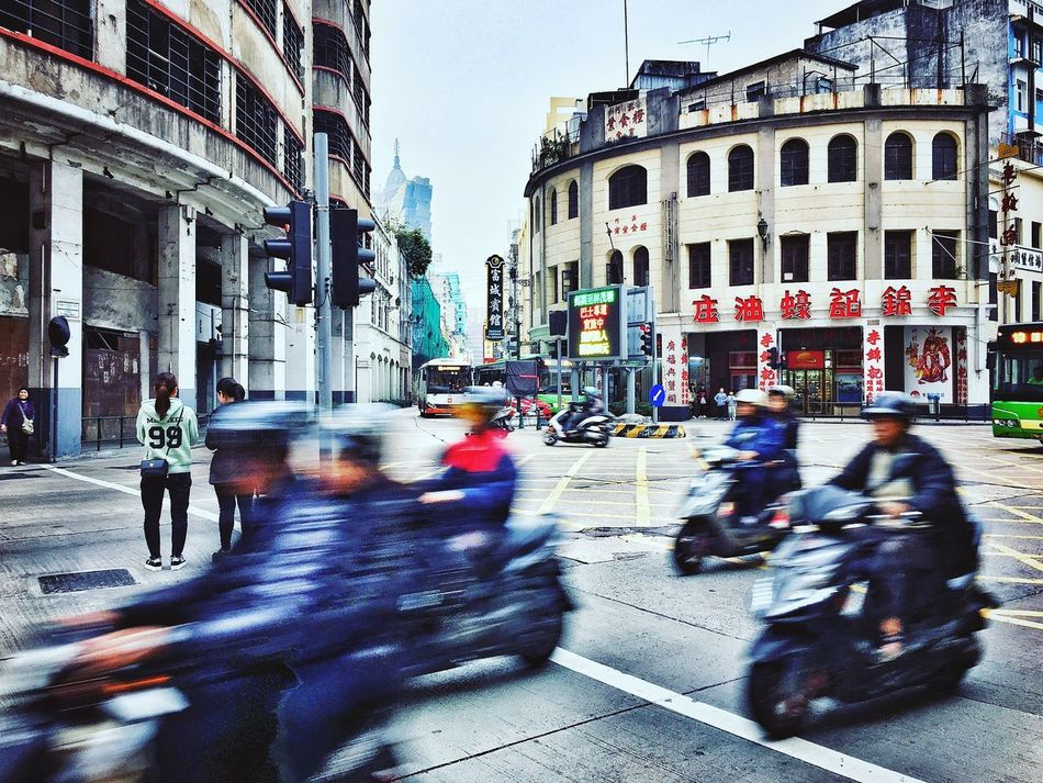 Street Building Exterior City City Street Blurred Motion City Life Built Structure Architecture Walking Land Vehicle Large Group Of People Real People Outdoors Group Of People Road Day Crowd People