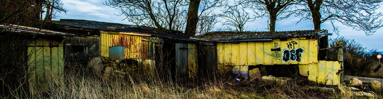 #daylight #farm #farmlife #garbage #junk #junkpile #metal Structure #old #yellow Abandoned Architecture Building Exterior Built Structure Cloud - Sky Damaged Day Grass House Landscape Nature No People Outdoors Sky Tree Tree Trunk
