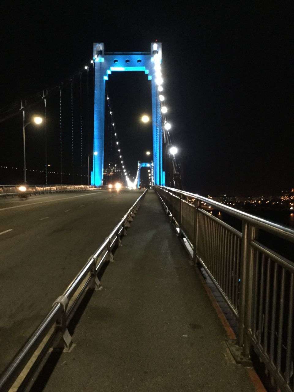 illuminated, night, bridge - man made structure, connection, architecture, the way forward, built structure, suspension bridge, transportation, outdoors, no people, road, sky, chain bridge, city