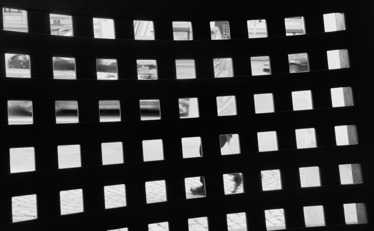 Learn & Shoot: Layering Life In Motion Chair Back Of A Chair Looking Through Getting Inspired Getting Creative Eye4photography  EyeEm Best Shots Week On Eyeem EyeEm Best Shots - The Streets Streetphotography Street Photography Shapes And Forms Squares Square Pattern From My Point Of View From Where I Stand Eye For Photography Layering