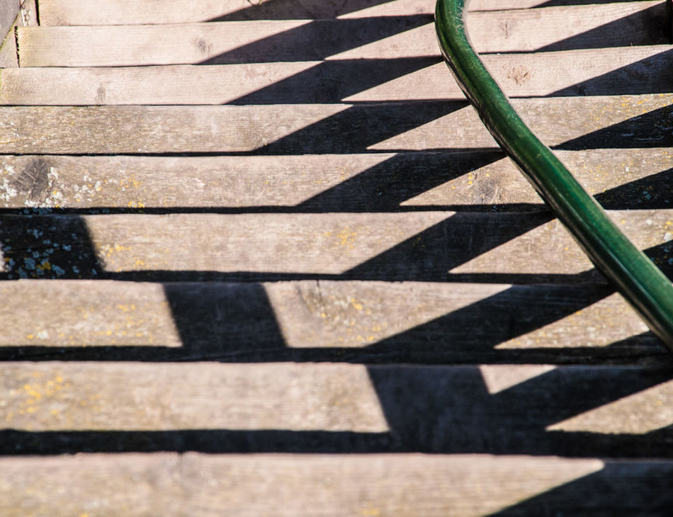 Close-up Day Elevated View Focus On Shadow Gardenhose Outdoors Shadow Shadow And Light Staircase Sunlight Wood Abstract
