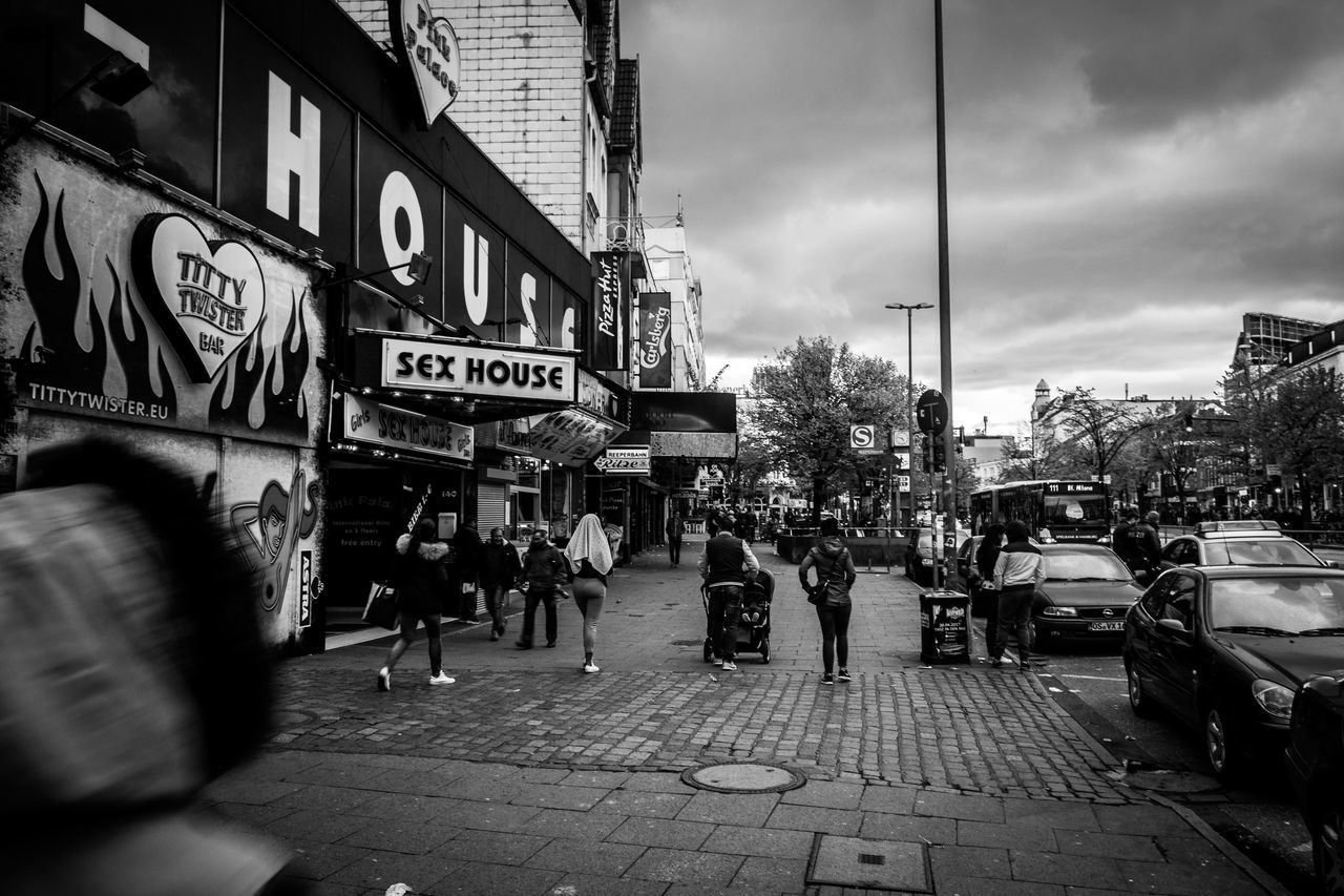 Reeperbahn Building Exterior City City Street Street Architecture Text City Life Outdoors Large Group Of People Built Structure People Day Crowd Adult Adults Only Sky Only Men Riot Blackandwhite Black & White Blackandwhite Photography Monochrome Reeperbahn  Streetphotography
