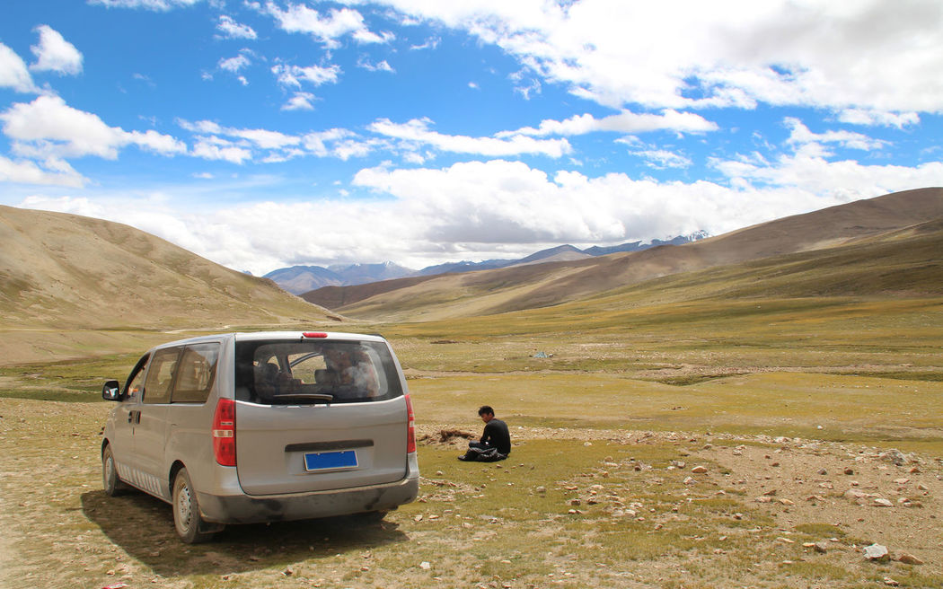 Tibetan driver take a rest Adventure Beauty In Nature Car Cloud - Sky Day Grass Hiking Land Vehicle Landscape Men Mountain Mountain Range Nature Non-urban Scene Outdoors People Real People Road Scenics Sky Sunlight And Shadow Sunny Day Tranquility Van