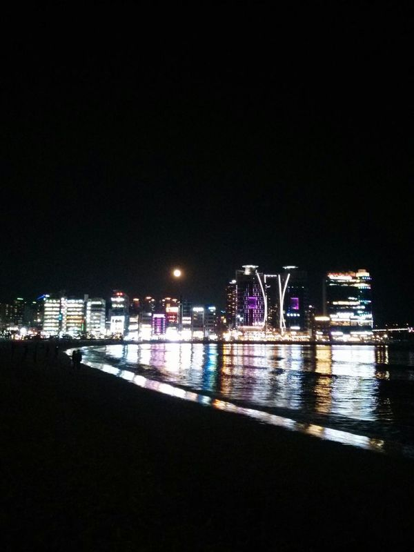 busan at night. · South Korea city lights Night Lights Night Photography Darkness Water reflections sea beach