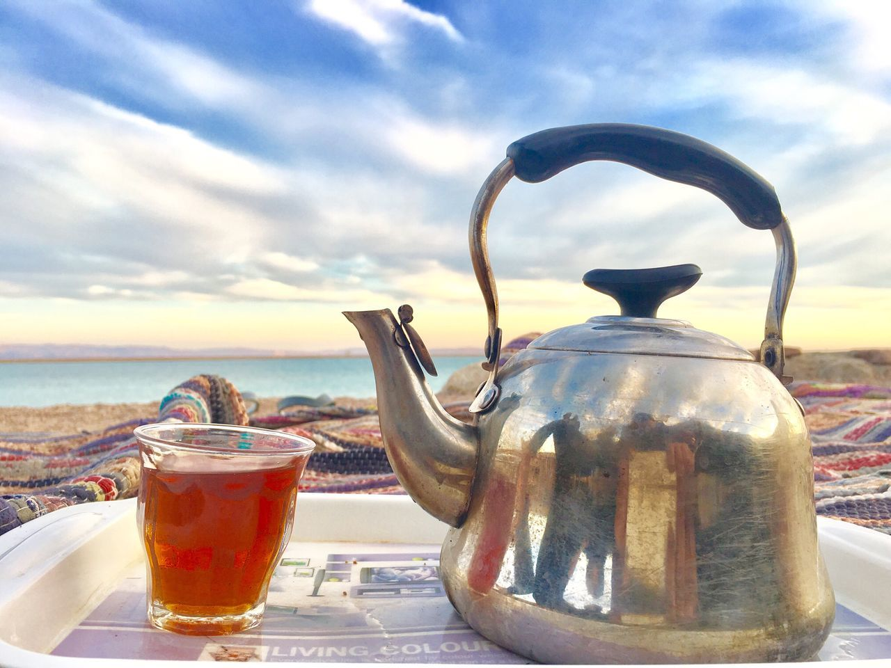 drink, refreshment, sky, sea, food and drink, sunlight, outdoors, teapot, drinking glass, cloud - sky, day, horizon over water, no people, tea - hot drink, water, nature, close-up, beauty in nature, mint tea, freshness