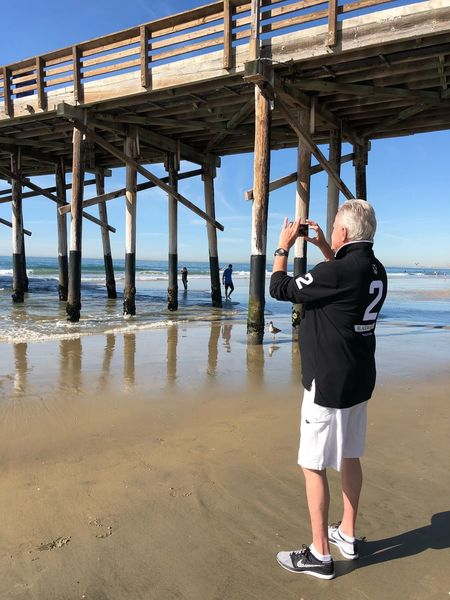 Picture taking Newport Beach Sports Clothing Sporty Man Ocean Photo Of The Day Photographer Pier Senior Adult Standing One Person Real People Full Length Leisure Activity Senior Men Day Sea Lifestyles Beach Outdoors Men Sport Water Nature Sky Adult One Man Only Adults Only