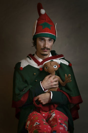 An Elf and E.T. E.T. Elf North Pole One Man Only Studio Shot Portrait Adult Looking At Camera Red Front View One Person Christmas People Young Adult Stage Costume