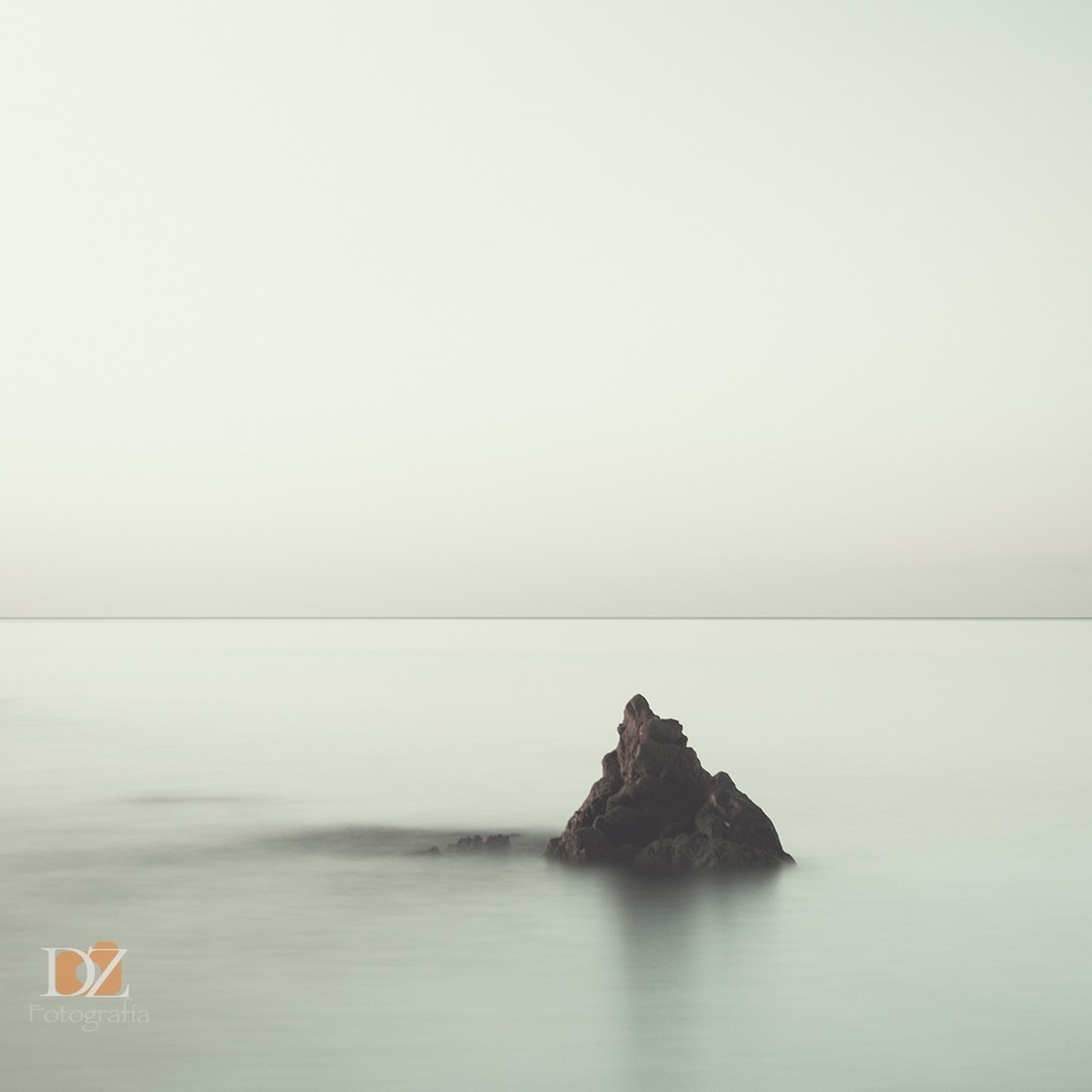 water, sea, copy space, tranquil scene, tranquility, scenics, clear sky, horizon over water, beauty in nature, waterfront, nature, rock - object, idyllic, calm, rock formation, remote, day, rock, non-urban scene, rippled