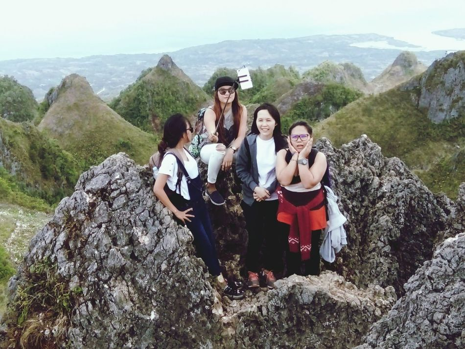 Real People Young Women Beautiful Woman Leisure Activity Adventure Mountainer Peak Friendship Dramatic Sky Mountain Tree Mountain Range Cloud - Sky Forest Travel Destinations