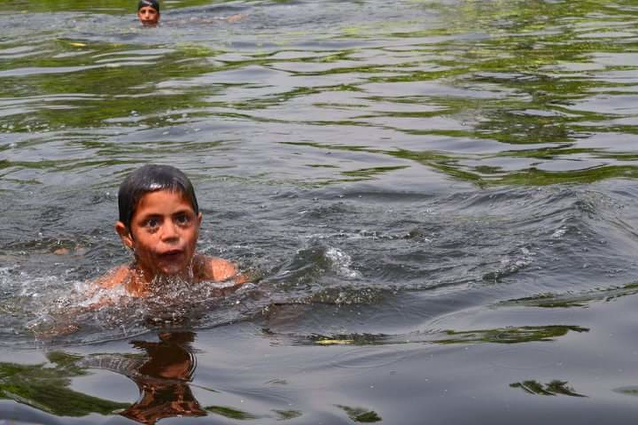 Srinagar Srinagar Kashmir Water Swimming Lifestyles Leisure Activity Rippled Looking At Camera Front View Person Day Nature Enjoyment Vacations Fun Summer Waterfront Innocence Tranquility Joy The Portraitist - 2016 EyeEm Awards