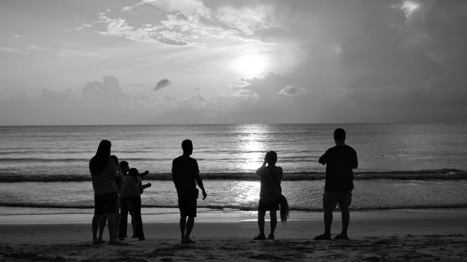 FIMLY GROUP ENJOYING AT BEACH Beach Beauty In Nature Friendship Full Length Horizon Over Water Leisure Activity Lifestyles Men Nature Outdoors Real People Sand Scenics Sea Shore Silhouette Sky Standing Sunlight Sunset Togetherness Vacations Water Wave Women