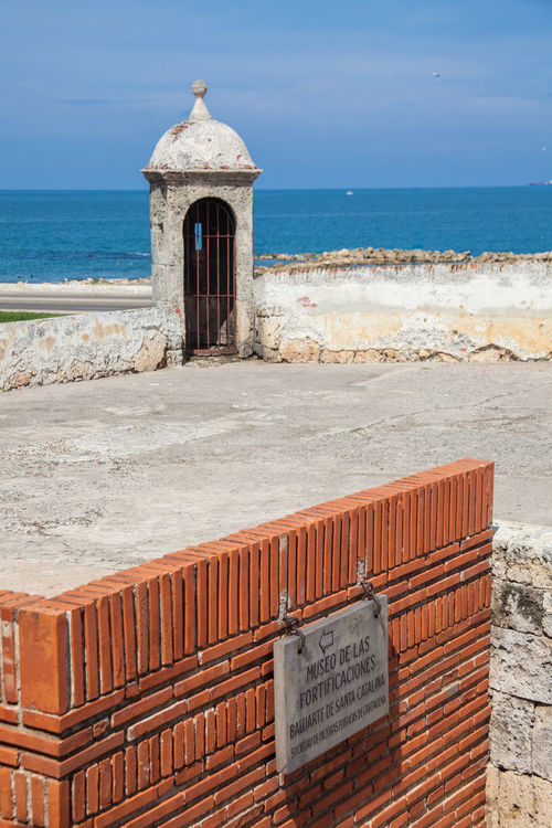 Santa Catalina Bulwark at Cartagena de Indias Architecture Cartagena Colombia Santa Catalina Wall Walled City Bartizan Blue Sky Built Structure Bulwark Caribbean Colonial Fortification Fortified Wall Historic Historical History Ocean Sea Stone Turret