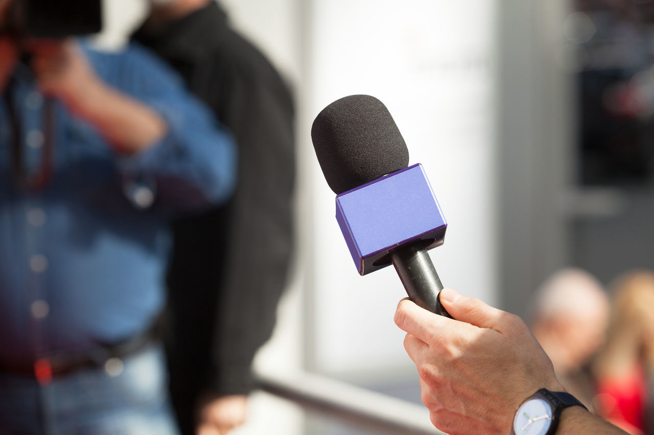 Microphone. Reporter making interview with microphone Adult Camerman Close-up Day Event Hand Holding Human Hand Indoors  Interview Interview Jornalistasdeimagens Men Microphone People People Watching Press Public Speaker Reporter Video Camera Women Working