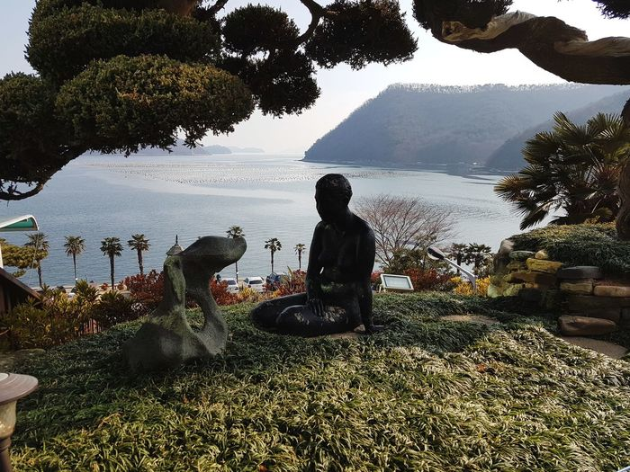 Sea And Sky Seascape Statue Water Sitting One Person Silhouette Nature People Beauty In Nature Sky Tree