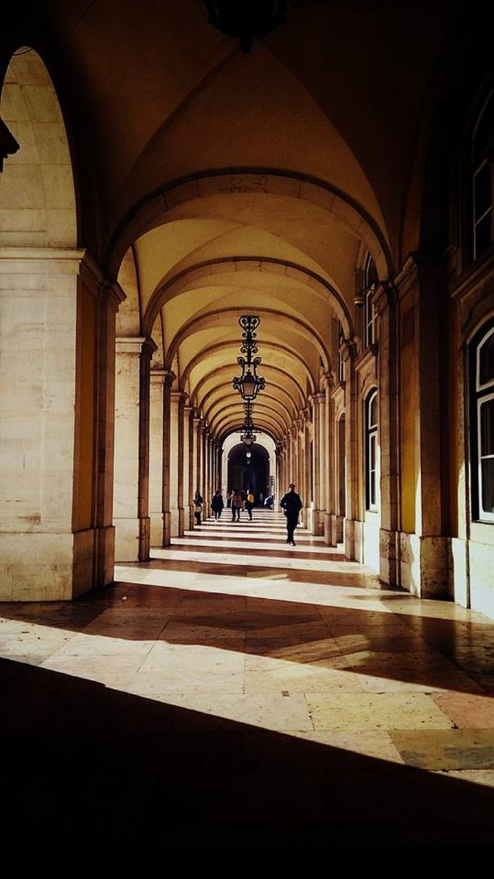 arch, built structure, architecture, architectural column, corridor, history, real people, indoors, the way forward, men, shadow, day, one person, people