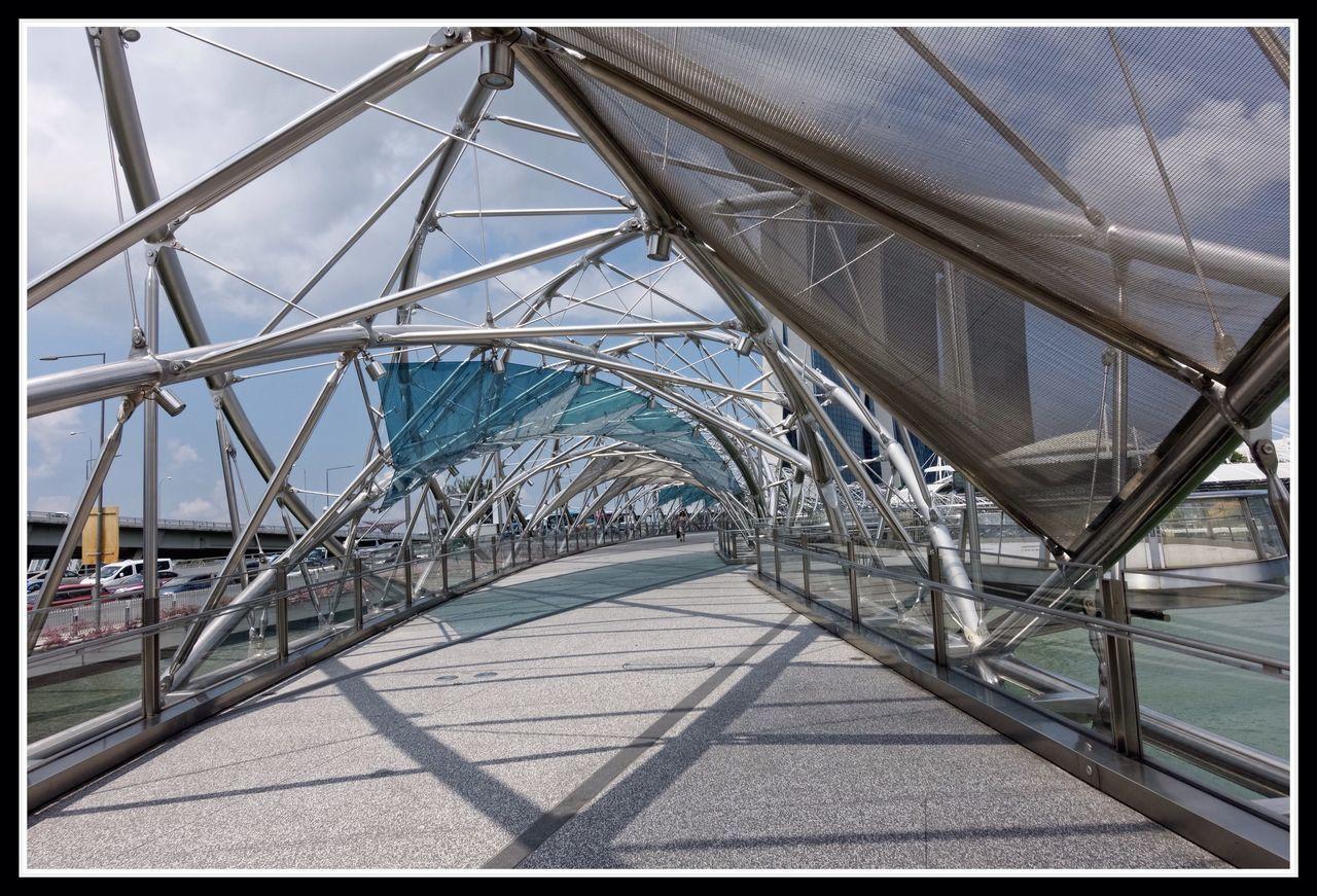 Pedestrian warp drive Bridge Outdoors Day Architecture Sky EyeEmNewHere Singapore Marina Bay Sands Science Fiction Bridge - Man Made Structure Triangle Geometry Geometric Abstraction Geometric Architecture Walking Walkway