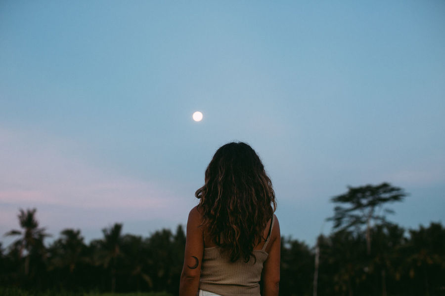 Waiting For The New Moon Bali Beauty In Nature Dusk Full Moon Moon Moon Moon Shots Moonlight Nature One Person Outdoors Real People Rear View Sky Tropical Waist Up