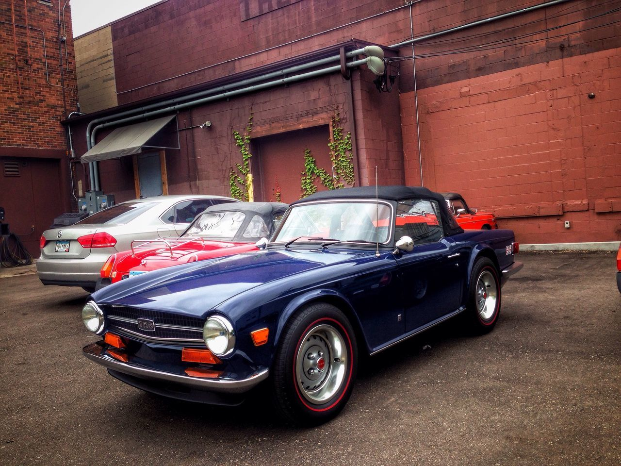 Triumph TR6 Classic British Cars Classic European Cars Enjoying Life Minneapolis Minnesota Bancroft Urban Landscape Cityscapes Afternoon Blues Urban Photography Urbanscape Urbanphotography Urban Lifestyle