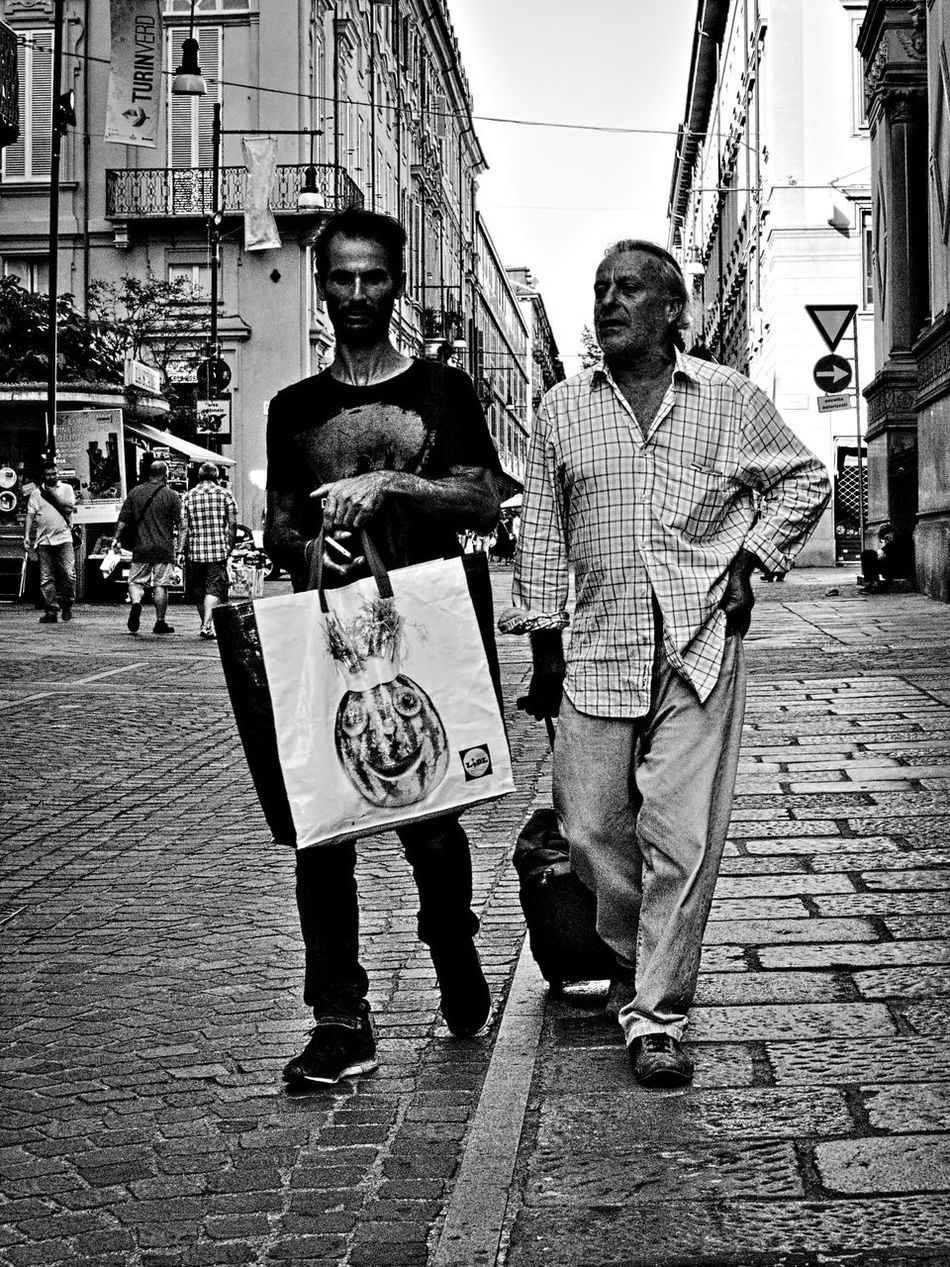 Two of us. Adult Archival Black And White Black And White Photography Bnw City City Life Friendship Homeless Homeless People Lifestyles Olympus Om-d E-m10 Outdoors People Person Portrait Street Street Life Street Photography Torino Italy Turin Turin Italy Walking People Monochrome Photography