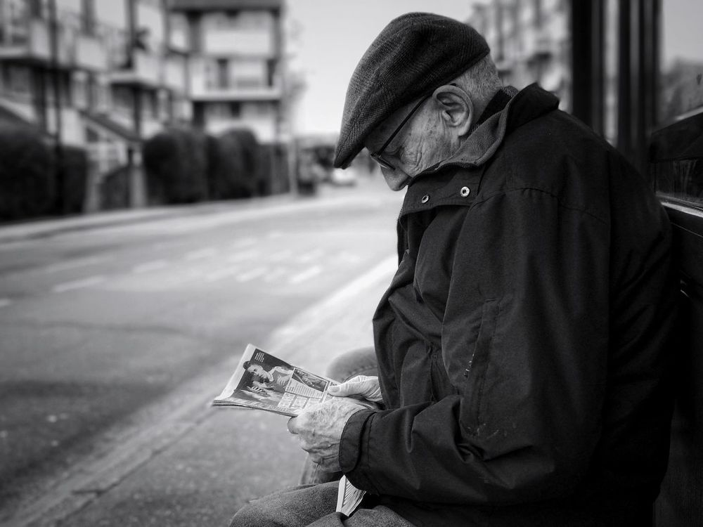 Real People Focus On Foreground One Person Men City Building Exterior Day Outdoors Architecture One Man Only People Adult Midle Ages Reading Newspaper