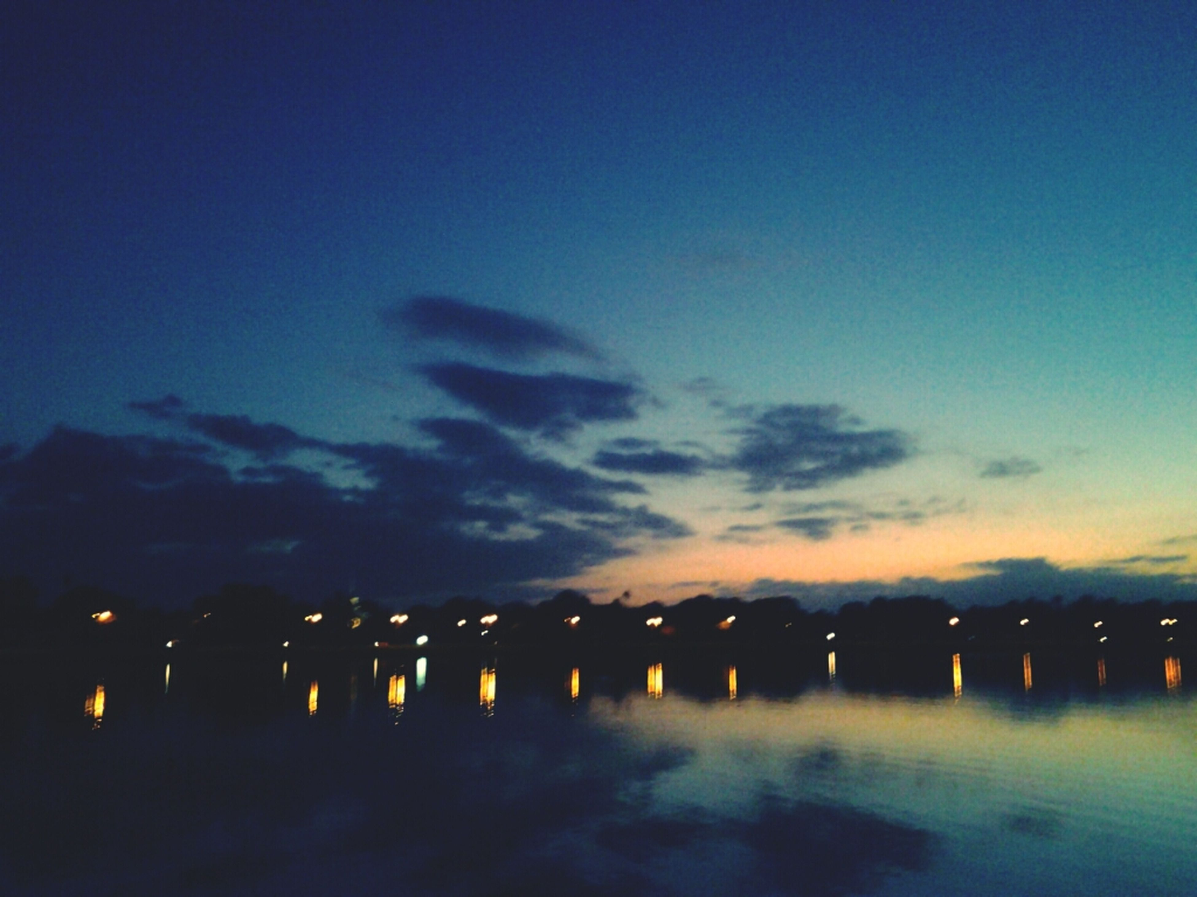water, waterfront, reflection, sunset, illuminated, sky, sea, silhouette, tranquility, scenics, tranquil scene, dusk, beauty in nature, pier, night, nature, idyllic, lake, cloud - sky, outdoors