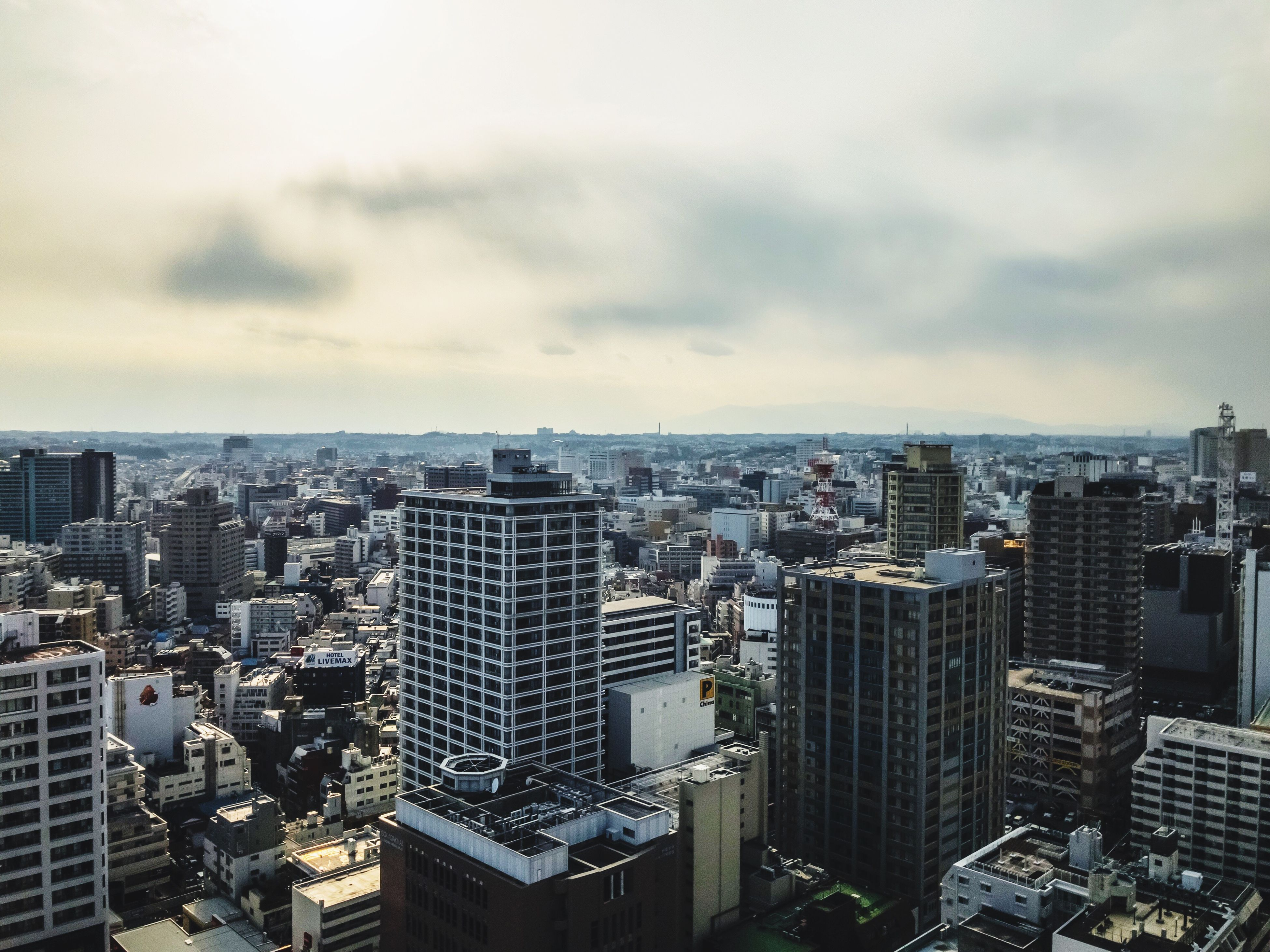 city, cityscape, building exterior, architecture, skyscraper, sky, travel destinations, modern, crowded, outdoors, cloud - sky, aerial view, built structure, urban skyline, downtown district, day, office park