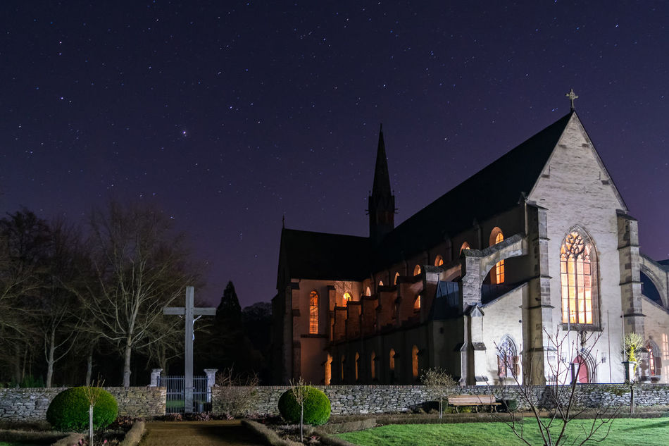 The basilica of the Cistercian monastery of Marienstatt, Germany Welcome To Black Building Galaxy Illuminated Landscape Night No People Outdoors Religion Religious Architecture Star - Space Travel