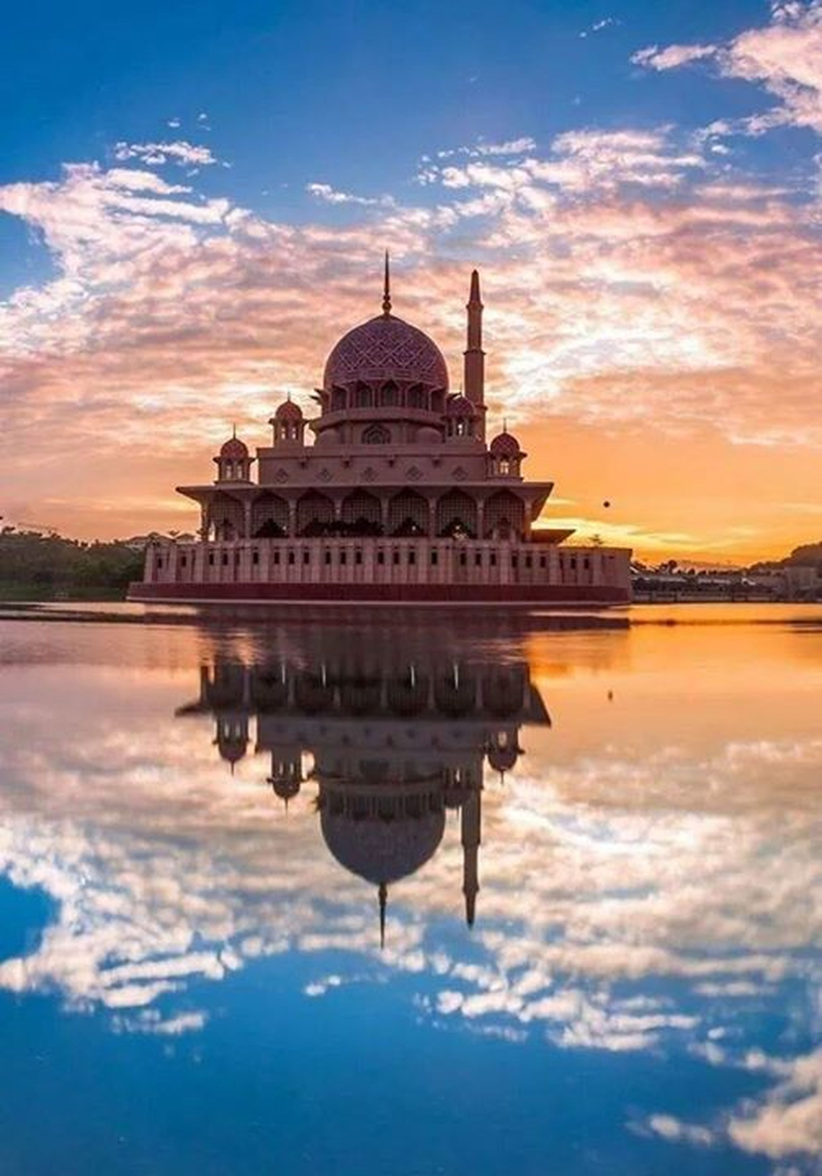 architecture, built structure, building exterior, famous place, sky, place of worship, sunset, travel destinations, tourism, religion, spirituality, dome, reflection, travel, international landmark, cloud - sky, water, history, waterfront, capital cities