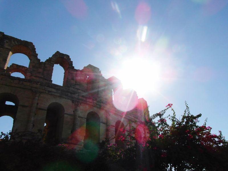 Sun Architecture Built Structure Sunbeam Sunlight Lens Flare Tunisia El Jem El Jem Coliseum Coliseum History Tourism Building Exterior Famous Place Old Ruin Ancient Sunny Sky Outdoors Arch The Past Deterioration
