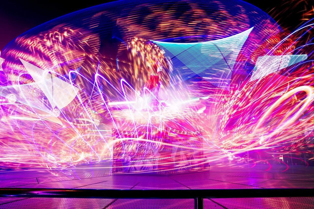 """""""Magic"""" Ride at the funfair in Annaberg-Buchholz Night Illuminated Light Trail Long Exposure Blurred Motion Speed Multi Colored Outdoors Kät Magic"""