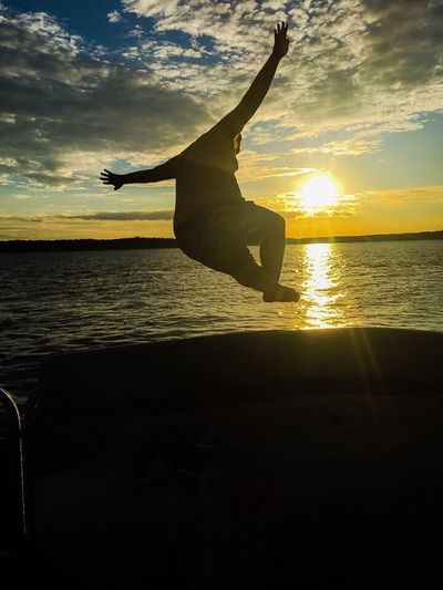 Chase flying into the sunset! Sunset Lake Kerrlake Labordayweekend