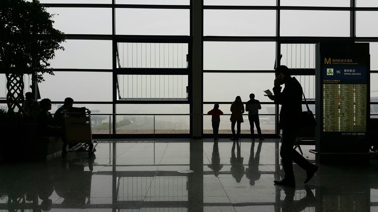 real people, men, indoors, silhouette, full length, women, airport, transportation, lifestyles, day, technology, architecture, people