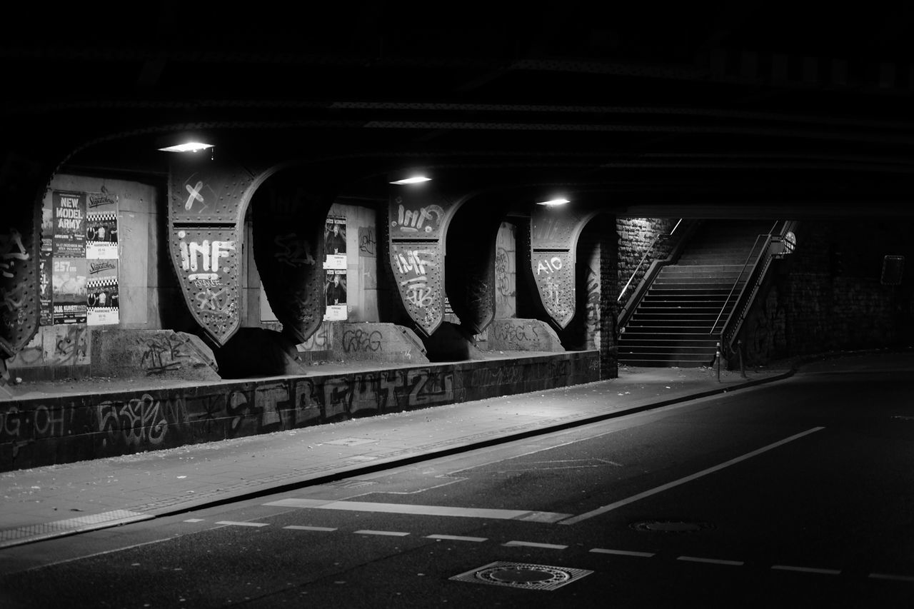 Illuminated Text Transportation No People Indoors  Architecture Built Structure Night Bridge - Man Made Structure Bnw Blackandwhite Black Night Lights Nightphotography Nightshot Darkness And Light Dark Grafitti Tags Steel Structure  Steel Headlight Streetphotography Street