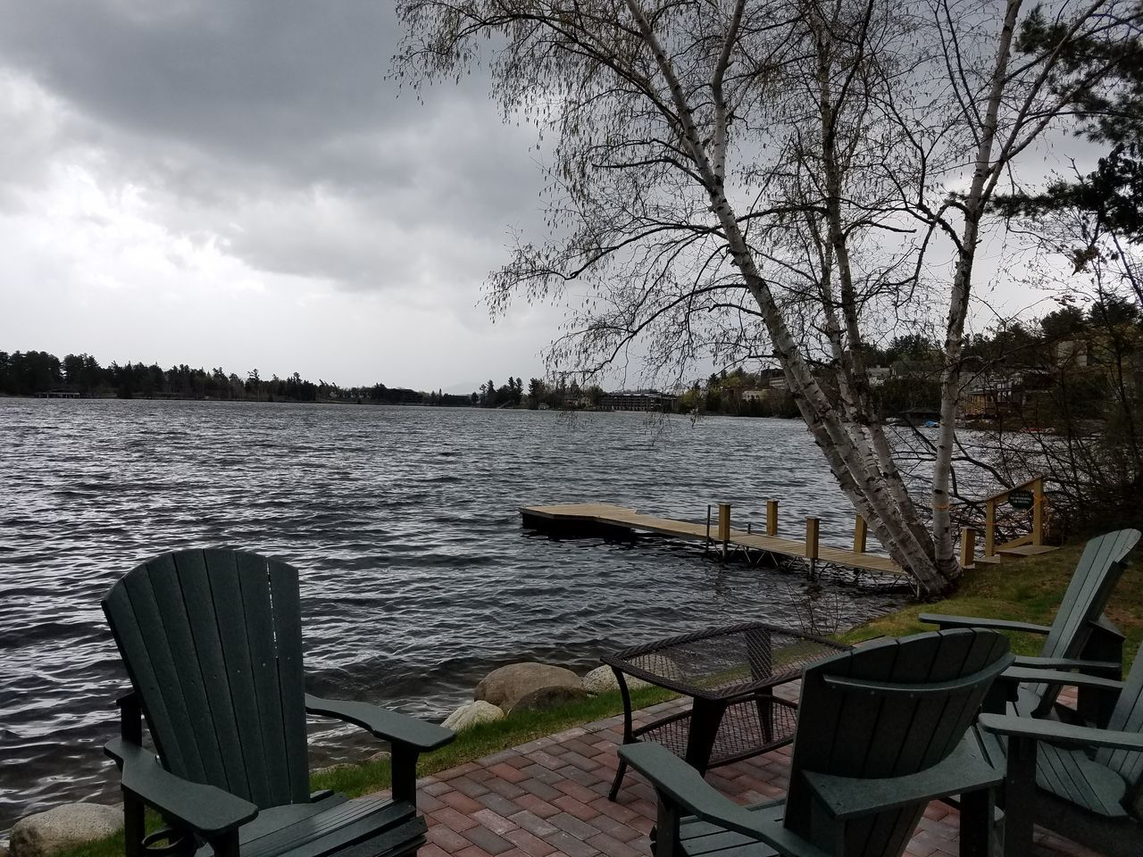 The peaceful serenity of a cloudy day by the lake Nature Outdoors Chair Day No People Tranquility Beauty In Nature Sky Water Tranquil Scene Remote Rock - Object Peace And Quiet Nature Mountain Landscape Scenics Cloudy Skies Clouds And Sky Cloudy Lake View Lake Placid, NY Mirror Lake Trees Dock