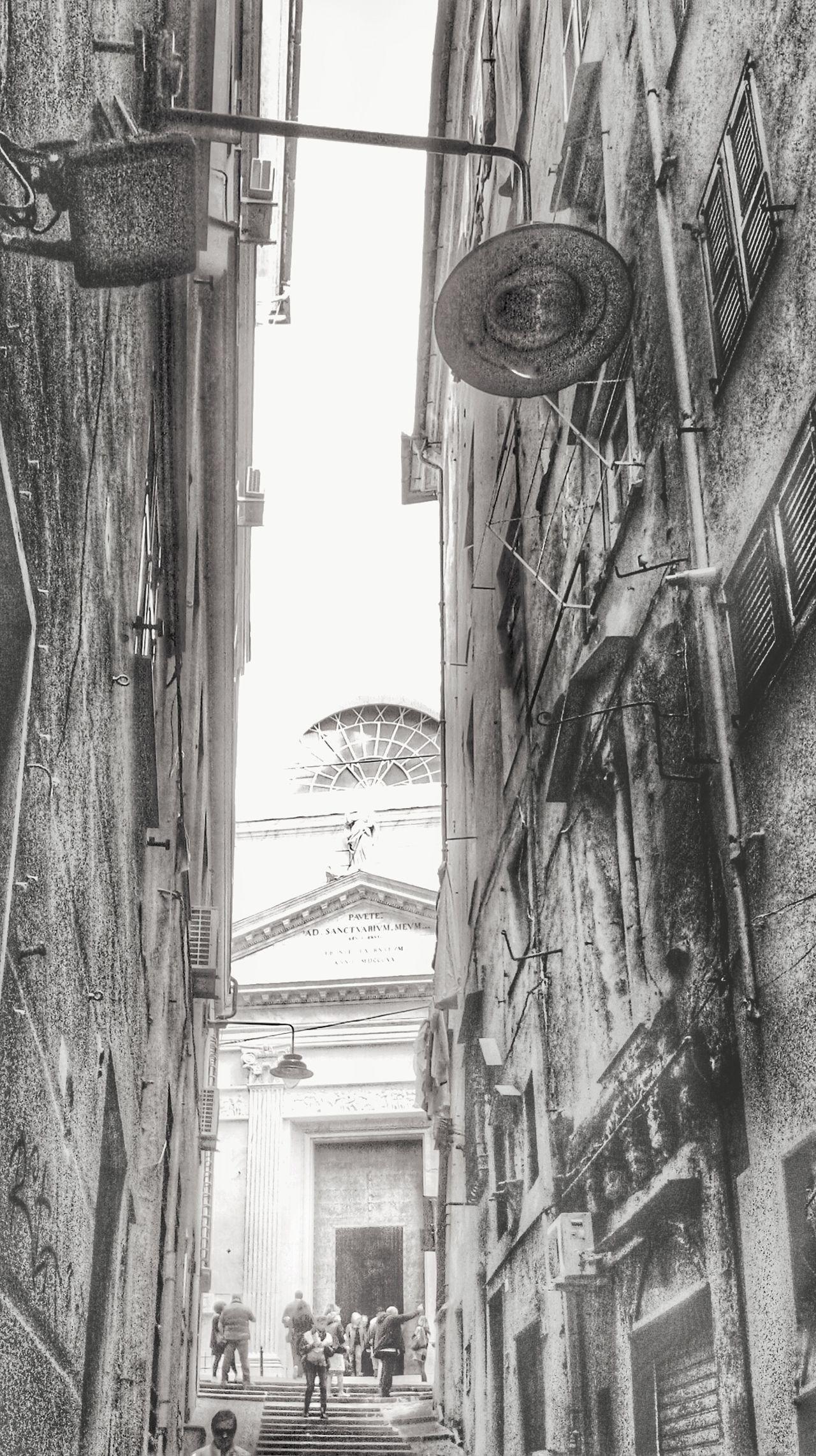 """Caroggio e gexa"". Caroggi Chiesa Alley Stairway Salita Narrow Street Vicoligenova Vicoli Centro Storico Di Genova Genova ♥ Genova Lampposts Churches Street Photography Mobile Photography S3mini Snapseed Bianco E Nero Black And White B&w"