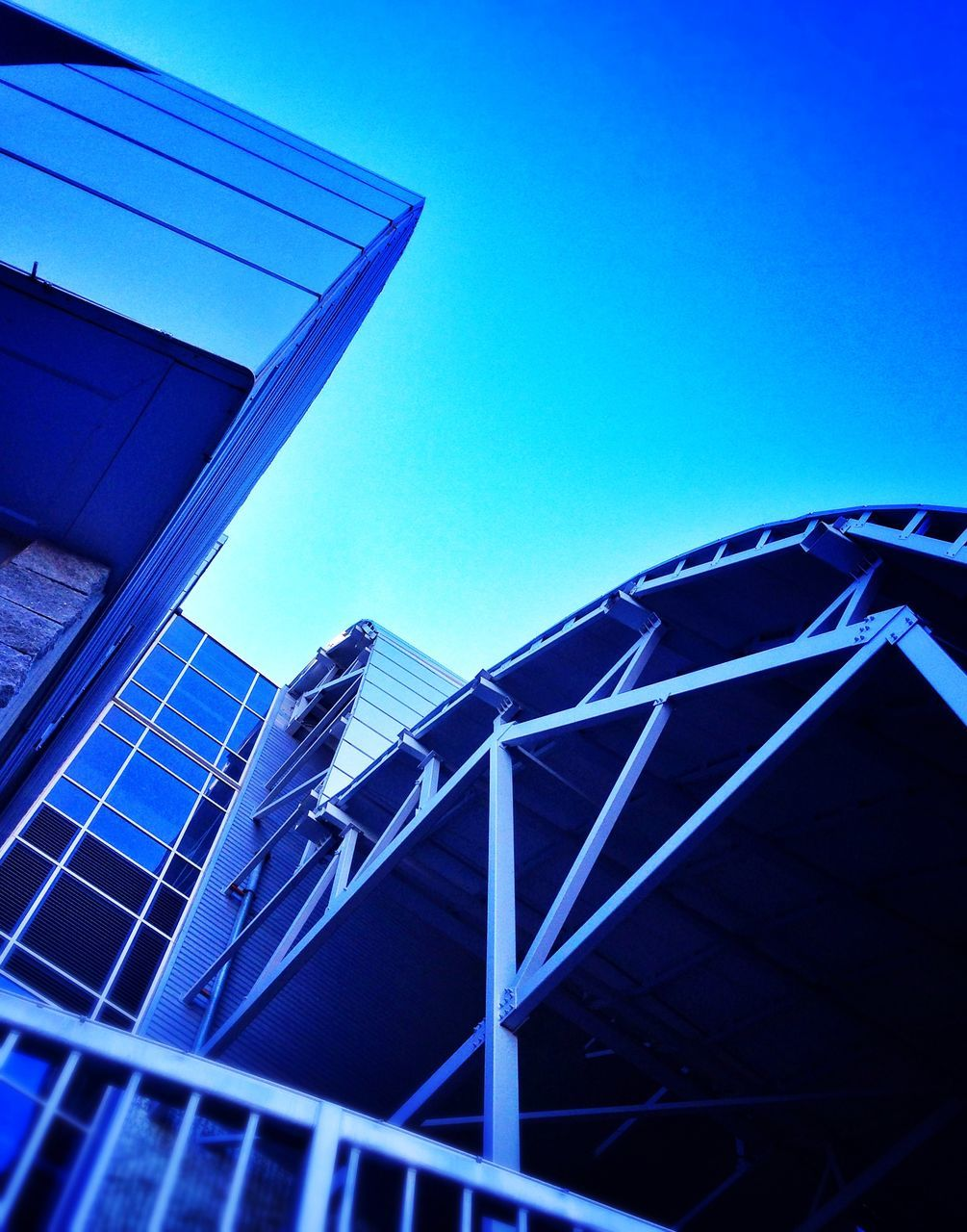 architecture, built structure, low angle view, building exterior, clear sky, blue, outdoors, day, no people, modern, city, sky