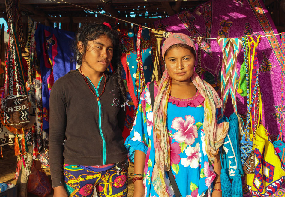 """""""Wayuu Artisans"""" - Cabo de la Vela, Colombia Wayuu is a colombian indigenous tribe living in north of the country (La Guajira). Ancestry Artesania Cabodelavela Colombia Colore Culture Cultures Family Girls Guajira, Colombia Indegenous Poeple Inspiration Natgeotravel Traditional Clothing Two People Wayuuculture Wayuutribe Women Power Uniqueness Uniqueness EyeEmNewHere"""
