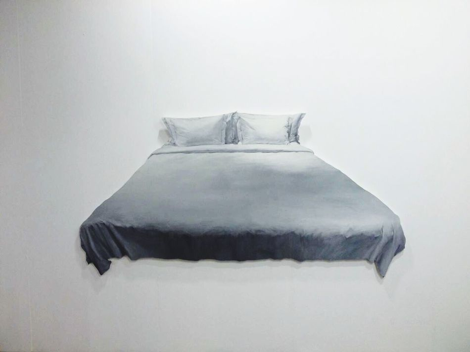 The bed on the wall At An Exhibition At A Conference Of Art