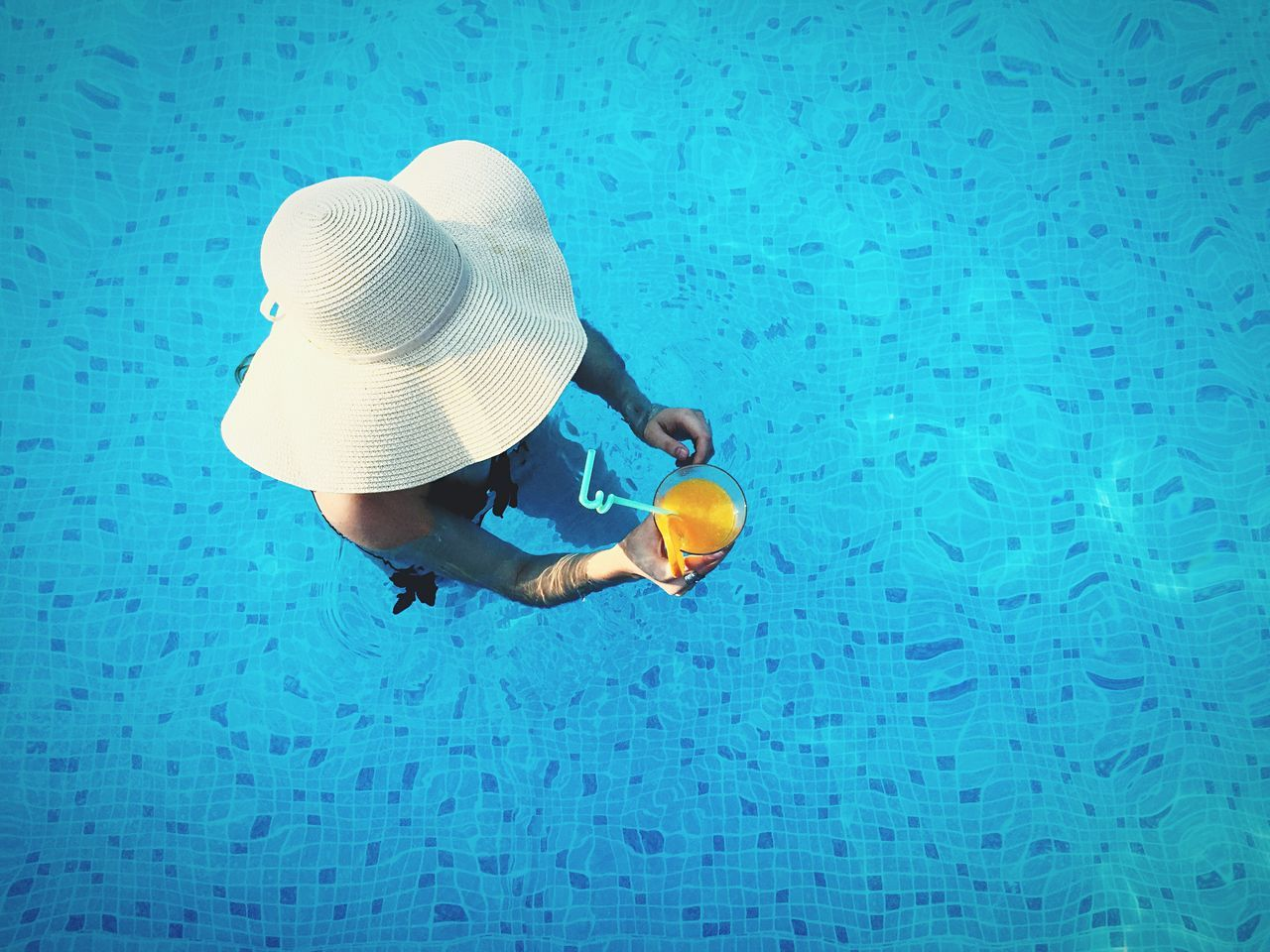 Pool Summer Girl Hat Drinks Orange Juice  Blue Water From Above  The Portraitist - 2016 EyeEm Awards TakeoverContrast