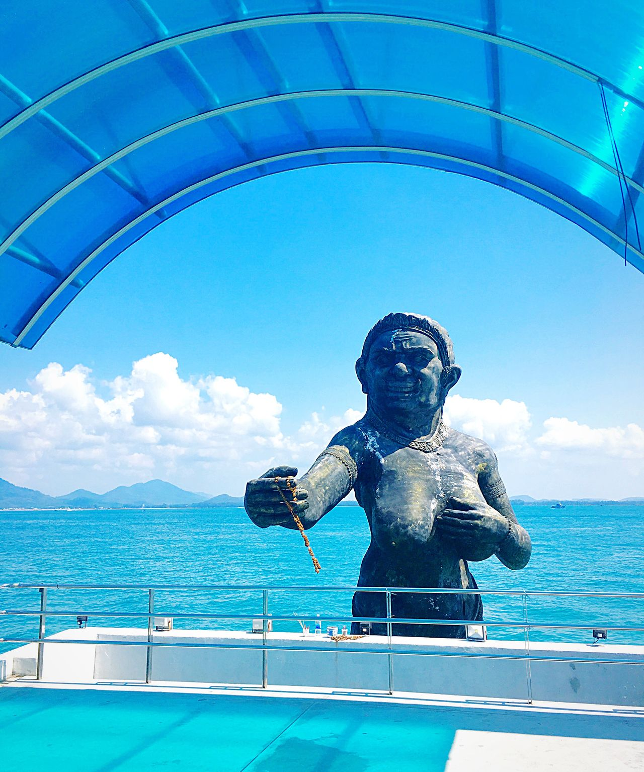 Statue Sea And Sky Stone Material Sculpture Stonemonument Blue Sky Blue Sea Sculpted Monument Simbol Pray Offering Dedication Wreath Garland Transportation Built Structure Resort Vacations Port Travel Thailand