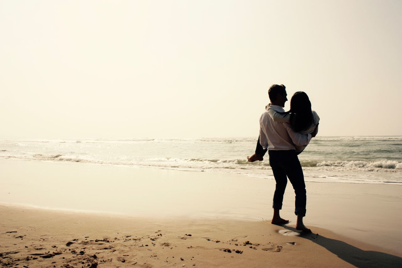 Beach Carrying Couple Engagement Photography Full Length In His Arms Light Love Nature Outdoors Relationship Romance Romantic Sand Sea Sky Togetherness Two People Wedding Photography