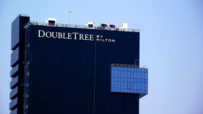 Architecture Black Blue Building Exterior Clear Sky Communication Day Doubletree Exit Sign Hilton Horizontal Hotel Low Angle View No People Outdoors Sky Text