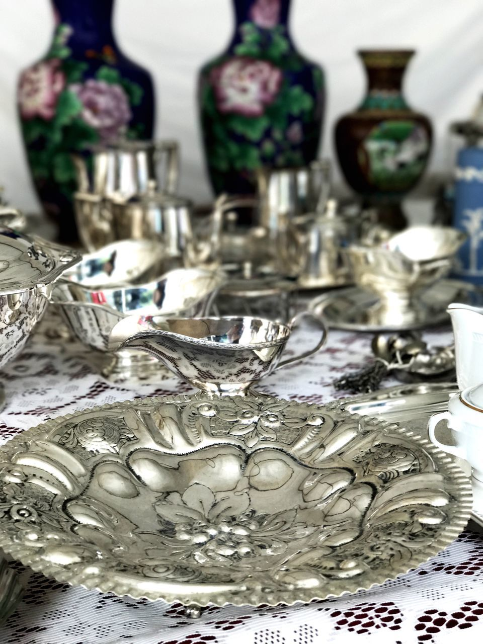 indoors, silver colored, large group of objects, close-up, no people, variation, abundance, collection, plate, day