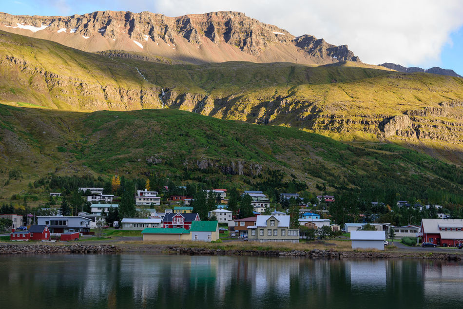 Peaceful view Day Europe Holiday Iceland Landscape Mountain Nature No People Outdoors Peaceful Peaceful View Reflection Relaxing Residential Building Scenics Seyðisfjörður Small Town Travel Destinations Vacations Water Miles Away